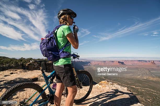 A woman mountain biking.