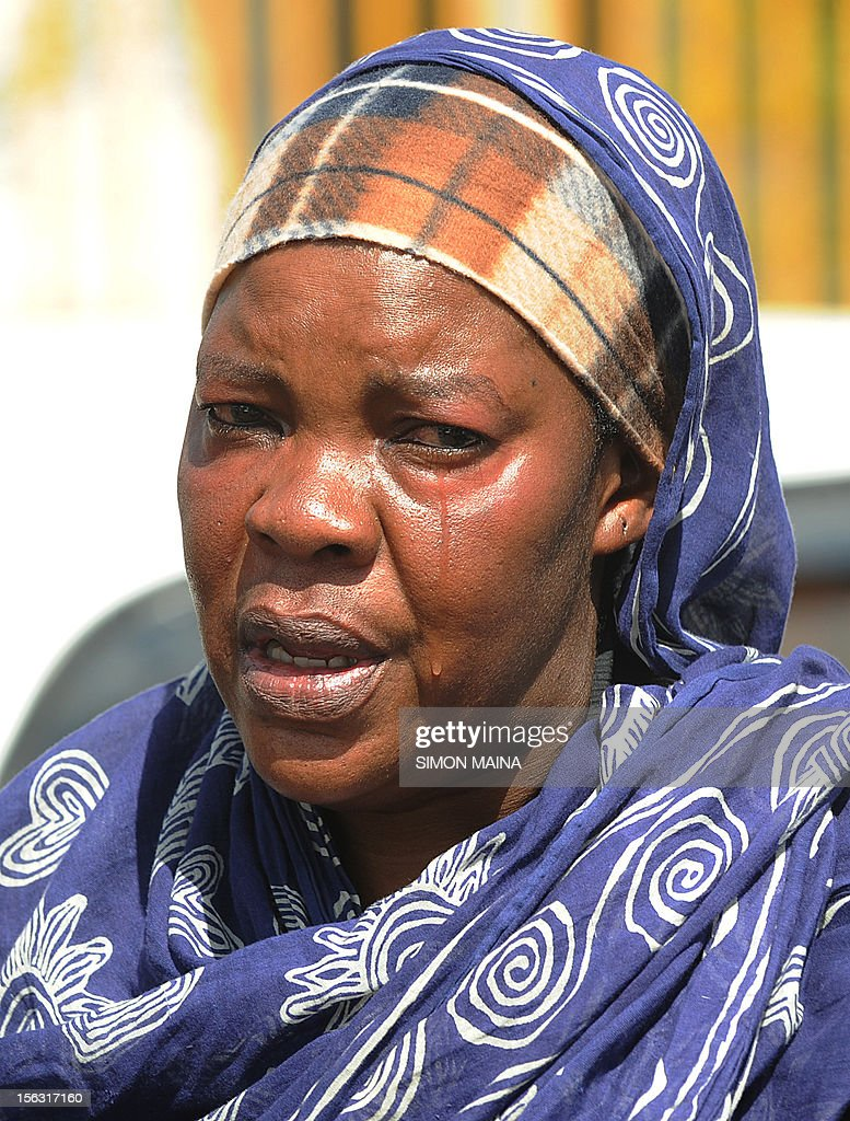 A woman mourns a relative killed by gunmen, at the Chiromo Mortuary in Nairobi on November 13, 2012, after 42 policemen were killed on November 10 by gunmen in the country's deadliest ambush in Baragoi, a remote district in Kenya's arid north. The death toll, of officers hunting cattle thieves, has risen to 42 after more bodies were found, police said.