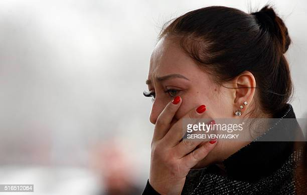 A woman mourns at the airport entrance in RostovonDon on March 19 after a Boeing passenger jet operated by the flydubai budget airline crashed...