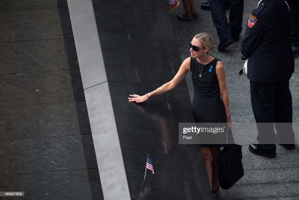 A woman mourns at the names plaques at the 9/11 Memorial during ceremonies for the 12th anniversary of the terrorist attacks on lower Manhattan at the World Trade Center site on September 11, 2013 in New York City. The nation is commemorating the anniversary of the 2001 attacks, which resulted in the deaths of nearly 3,000 people after two hijacked planes crashed into the World Trade Center, one into the Pentagon in Arlington, Virginia and one crash landed in Shanksville, Pennsylvania. Following the attacks in New York, the former location of the Twin Towers has been turned into the National September 11 Memorial & Museum.