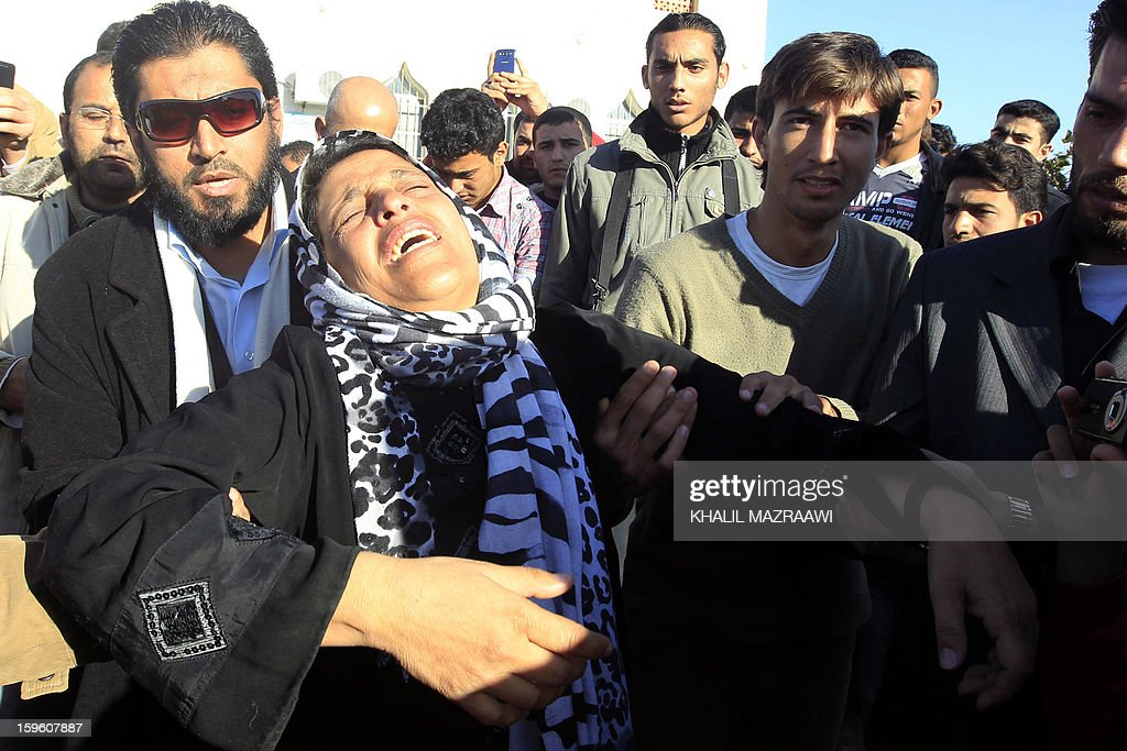 A woman mourns during the funeral of the Syrian refugees who were killed the day before during an explosion in the northern city of Ramtha, which houses hundreds of refugees, on January 17, 2013. Eight Syrian refugees were killed when a kerosene heater exploded and the caravan in which they were living caught fire, and another four were hurt in the incident.