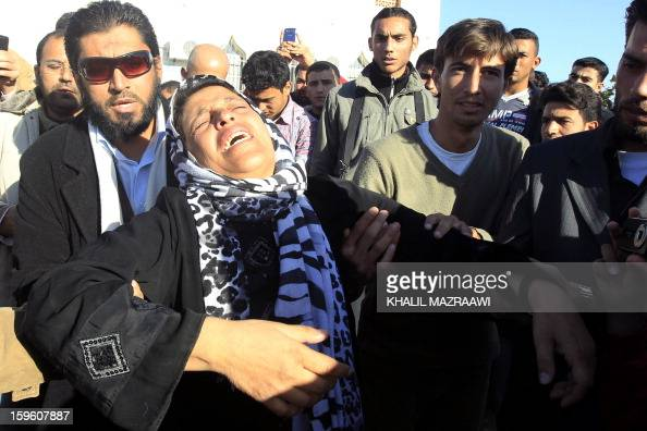 A woman mourns during the funeral of the Syrian refugees who were killed the day before during an explosion in the northern city of Ramtha which...