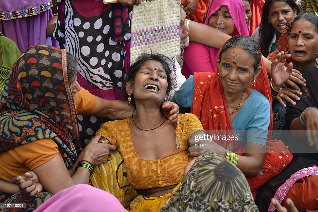 A woman mourns following the death of a relative in an explosion at a scrapyard in Agra on April 25, 2013. An explosion in a scrapyard near the world-famous Taj Mahal in northern India city of Agra killed two men and injured a woman, police said Thursday. The blast occurred four kilometers (two miles) from the white marble mausoleum, known as the 'monument of love,' as scrapyard workers attempted to separate explosives from metal scrap bought from the army.