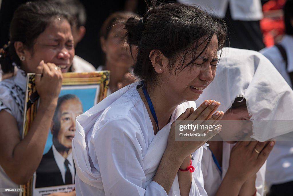 A woman mourns for former King Norodom Sihanouk as the coffin is paraded through the streets of Phnom Penh on February 1, 2013 in Phnom Penh, Cambodia. Over half a million mourners lined the streets to pay their respects during the funeral procession which finished at the crematorium where his funeral pyre will be lit by his wife and son on the 4th of February. King Norodom Sihanouk died of a heart attack last October in Beijing at the age of 89. For the past three months his body has been lying in state at the Royal Palace.