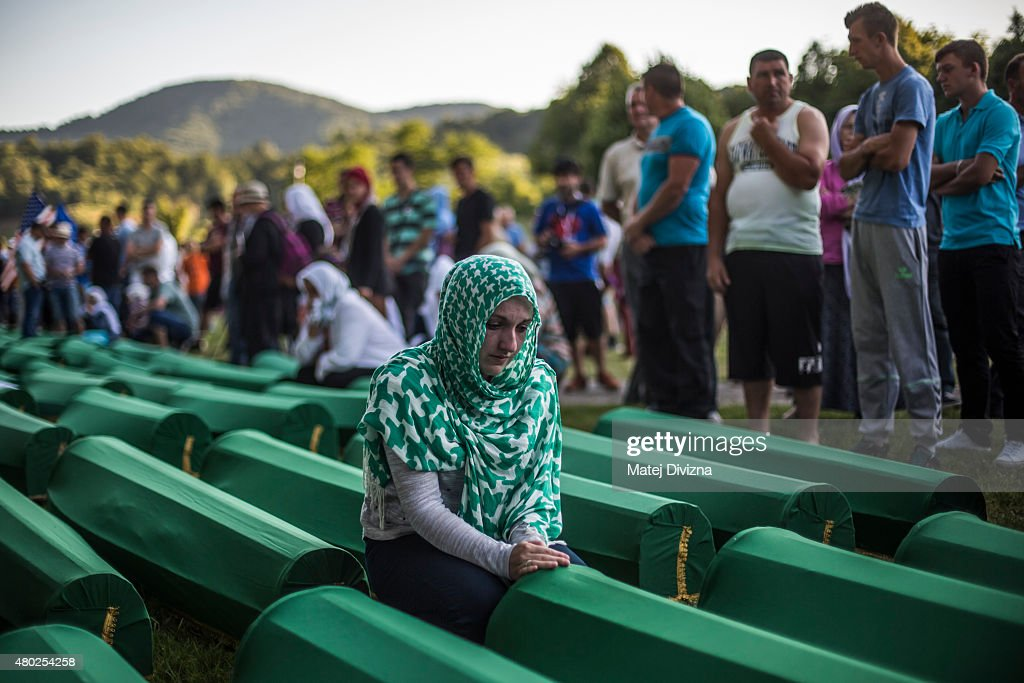 A woman mourns over a coffin among 136 coffins of victims of the 1995 Srebrenica massacre at the Potocari cemetery and memorial near Srebrenica on July 10, 2015 in Srebrenica, Bosnia and Herzegovina. The newly-identified remains of another 136 victims from Srebrenica massacre will be buried at the ceremony on July 11, 2015 on the 20th anniversary of the massacre. At least 8,3000 Bosnian Muslim men and boys who had sought safe heaven at the U.N.-protected enclave at Srebrenica were killed by members of the Republic of Serbia (Republika Srpska) army under the leadership of General Ratko Mladic, who is currently facing charges of war crimes at The Hague, during the Bosnian war in 1995.