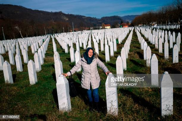 TOPSHOT A woman mourns over a relative's grave at the memorial centre of Potocari near Srebrenica on November 22 2017 United Nations judges on...