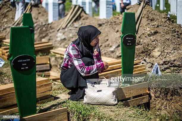A woman mourns over the opengrave before the mass funeral for 136 newlyidentified victims of the 1995 Srebrenica massacre attended by tens of...