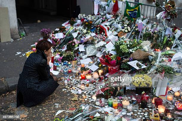 A woman mourns the victims near the Bataclan concert hall on November 16 2015 in Paris France A Europewide oneminute silence was held at 12pm CET...