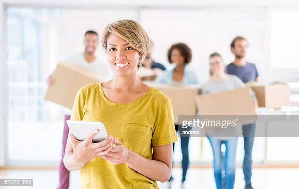 Woman moving and using a tablet