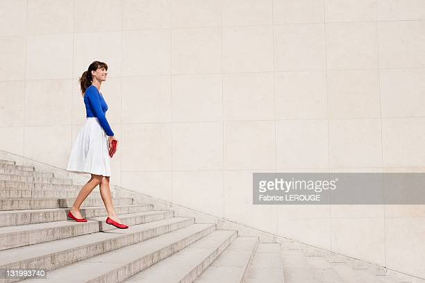 Woman moving down steps, Paris, Ile-de-France, France