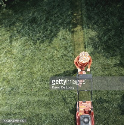 Woman moving grass, elevated view