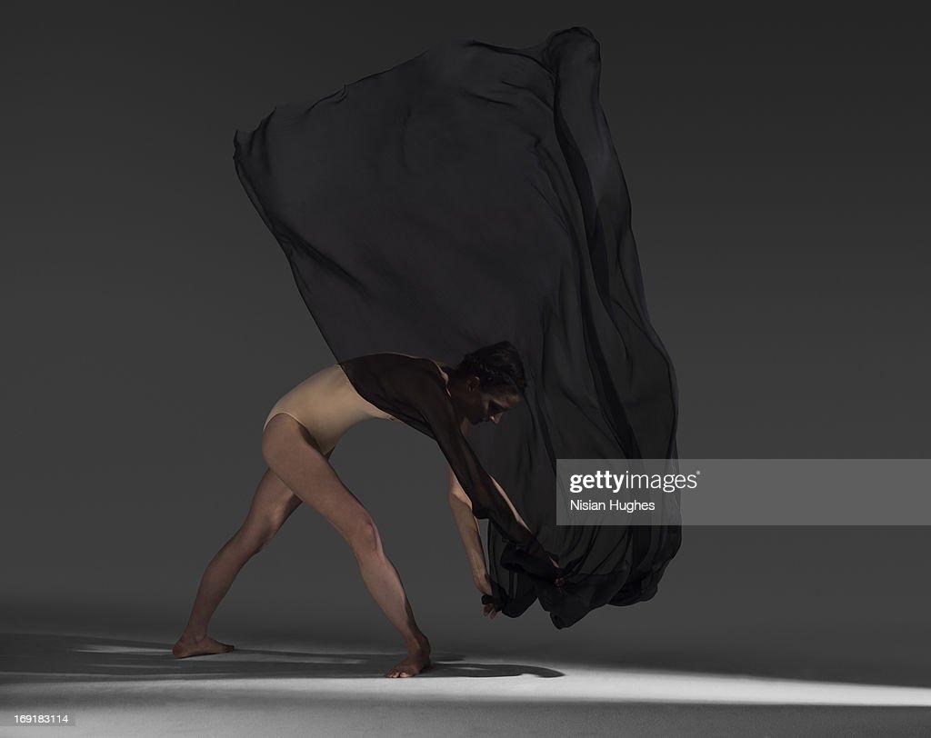 woman moving silk fabric through the air : Stock Photo