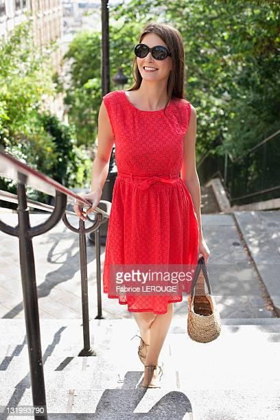 Woman moving up staircases, Montmartre, Paris, Ile-de-France, France