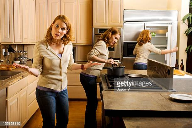 Woman multitasking in the a kitchen