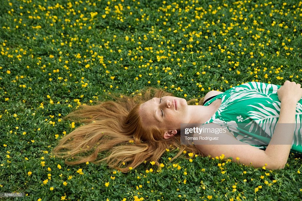 Woman Napping in a Meadow : Stock Photo
