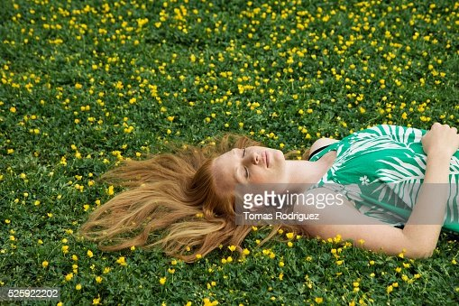 Woman Napping in a Meadow : Stockfoto