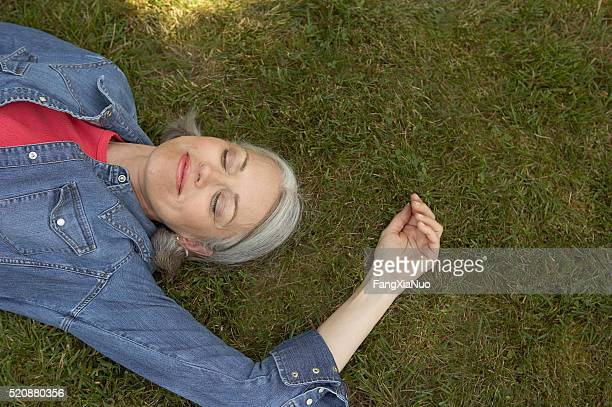 Woman napping outdoors