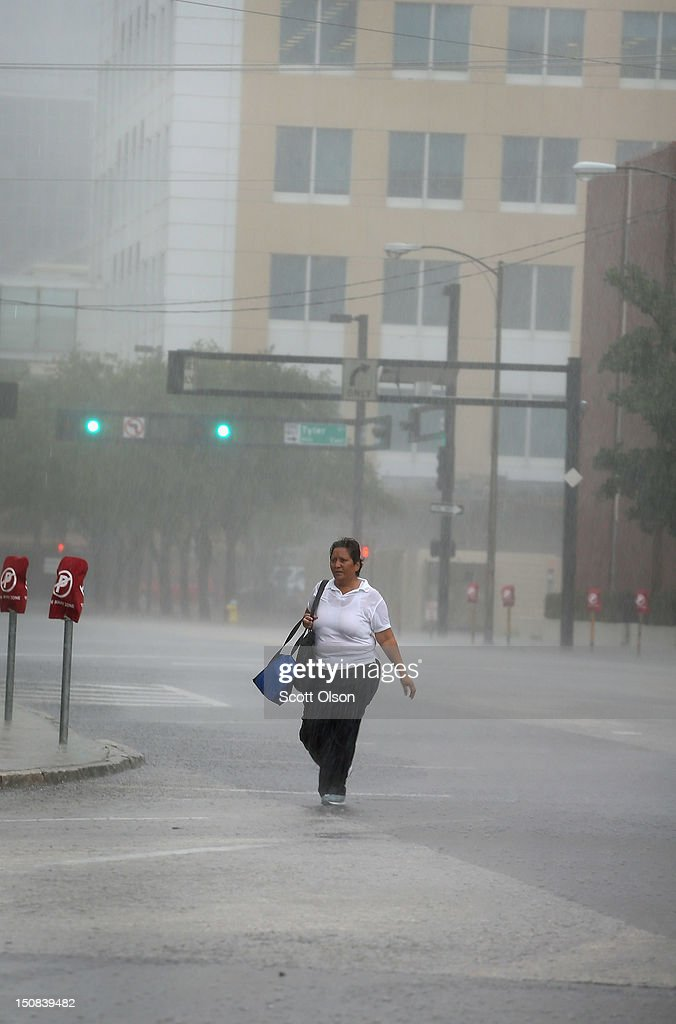 A woman navigates a downtown street during a downpour following the opening session of the Republican National Convention on August 27, 2012 in Tampa, Florida. The RNC convened today, but will hold its first full session tomorrow after being delayed due to Tropical Storm Isaac.