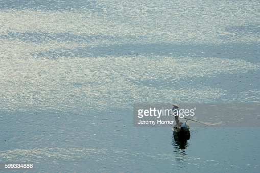 Woman Navigating Punt Across Water
