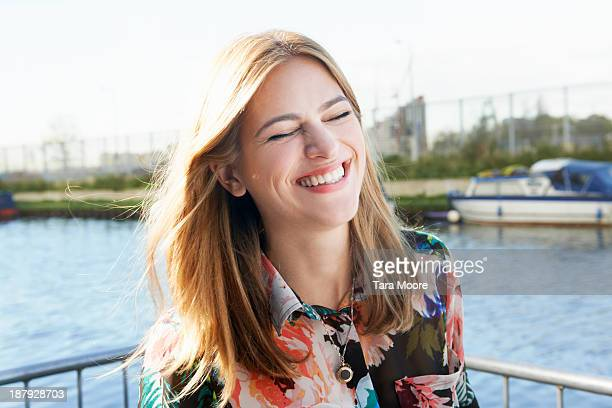 woman near lake laughing