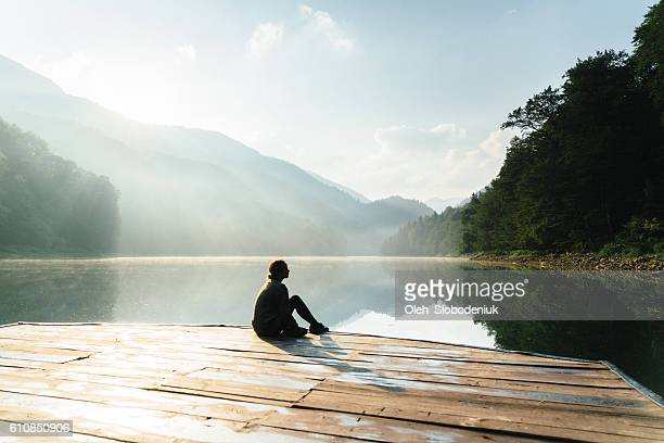 Woman near the lake in mountains