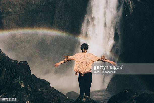 Woman near the waterfall