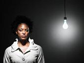 woman next to exposed light