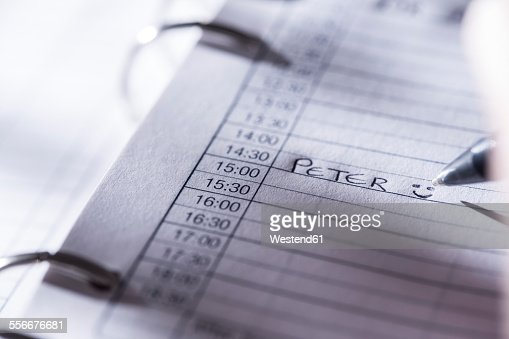 Woman noting date in day planner