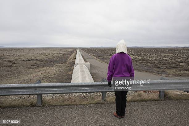 A woman observes one of two vacuum chambers measuring four kilometers in length during a public tour at the Laser Interferometer GravitationalWave...