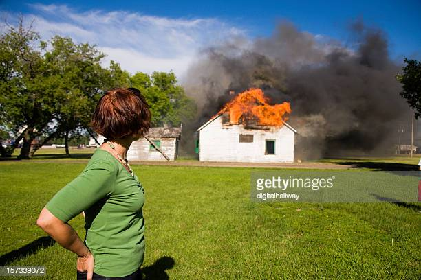 Woman observing house fire