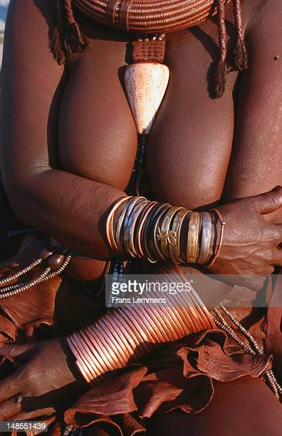 Woman of Himba tribe with decorative jewellery.