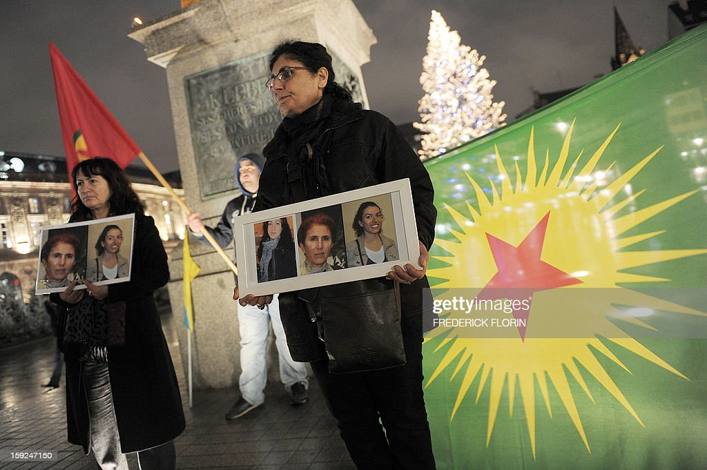A woman of Kurdish origin holds a frame with photos of three Kurdish women activists, Sakine Cansiz, Fidan Dogan, Leyla Soylemez, killed yesterday in Paris, during a demonstration on January 10, 2013, in Strasbourg, eastern France. A co-founder of the Kurdistan Workers' Party (PKK) and two other militants were found shot dead on January 10 in Paris, a day after Turkey and the jailed leader of the banned group were reported to have agreed on a peace plan to end a three-decade-old insurgency.