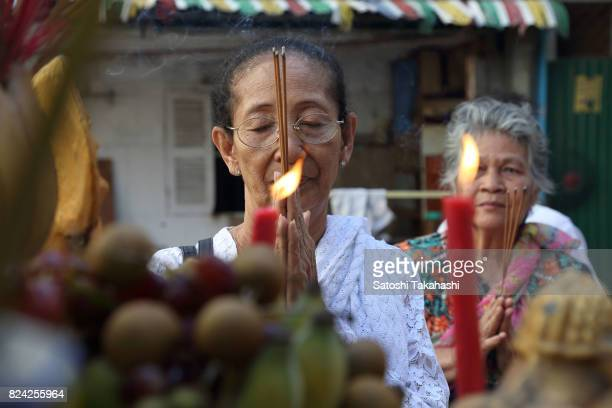 A woman of resident of White Building prays to God during a farewell ceremony at Phnom Penh's iconic White Building It was built in 1963 as a modern...