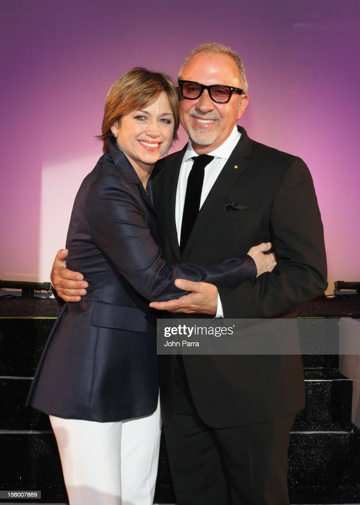 Woman of Substance and Style Honoree Dorothy Hamill poses with celebrity presenter Emilio Estefan at Destination Fashion 2012 To Benefit The Buoniconti Fund To Cure Paralysis, the fundraising arm of The Miami Project to Cure Paralysis, on November 10, 2012 at Bal Harbour Shops in Miami, Florida.