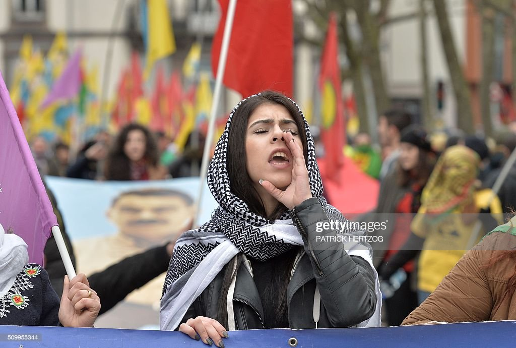 A woman of the Kurdish community takes part in the annual rally of Kurds from all over Europe to denounce the detention of jailed leader of Turkey's Kurd rebels, Abdullah Ocalan, on February 13, 2016, in Strasbourg, eastern France. Ocalan was captured by Turkish undercover agents in Kenya in 1999, brought back to Turkey and sentenced to death. His sentence was later commuted to life. / AFP / PATRICK HERTZOG