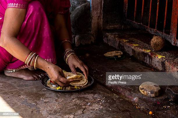 A woman offer sweet and puri to the Goddess on the last day of Navratri in Santoshi Mata temple Navratri is one of the holiest Hindu festivals where...