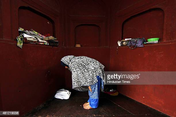 A woman offers prayer during EidulFitr at Jama Masjid mosque on July 18 2015 in New Delhi India Muslims around the world are celebrating the...