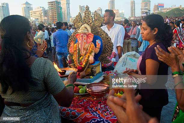 A woman offers prayers to lord Ganesha at Girgaum Chowpatty in Mumbai before the immersion of lord Ganesha Ganesha Chaturthi or Ganapati festival is...
