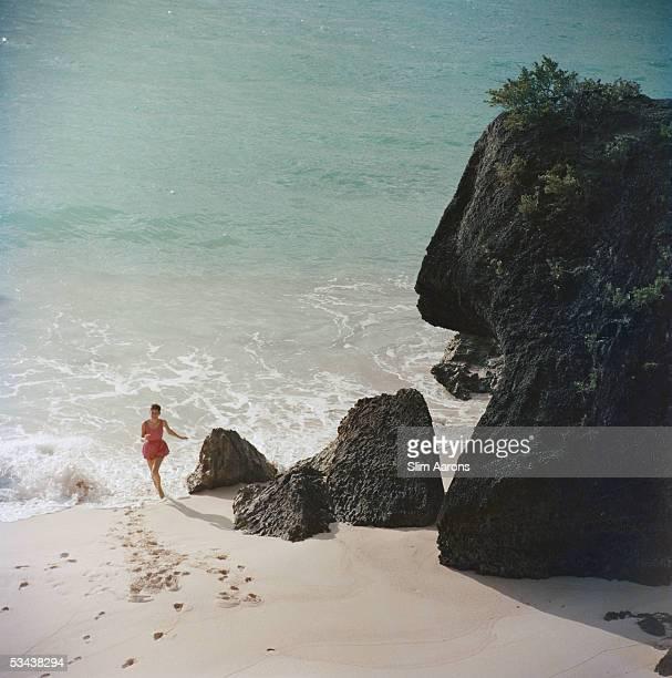 A woman on a beach in Bermuda 1957