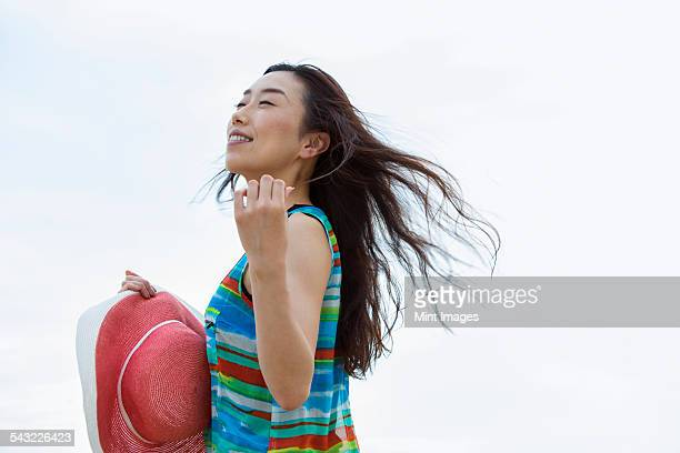 A woman on a beach in Kobe.