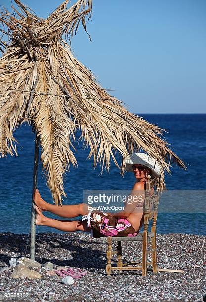 A woman on a beach near Lindos on July 16 2009 in Rhodes Greece Rhodes is the largest of the Greek Dodecanes Islands