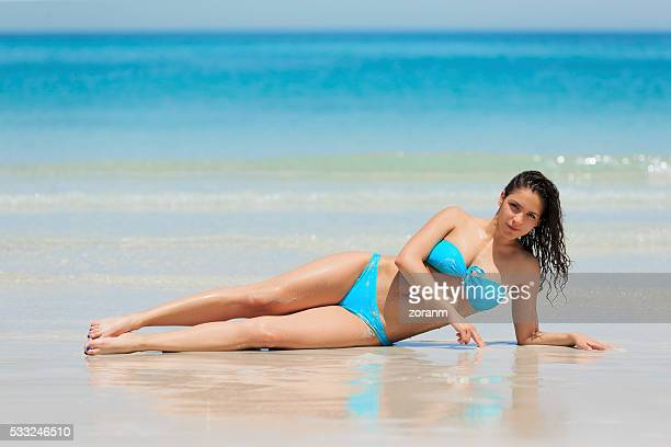 Woman on a beach sunbathing