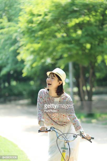 woman on a bicycle in a park