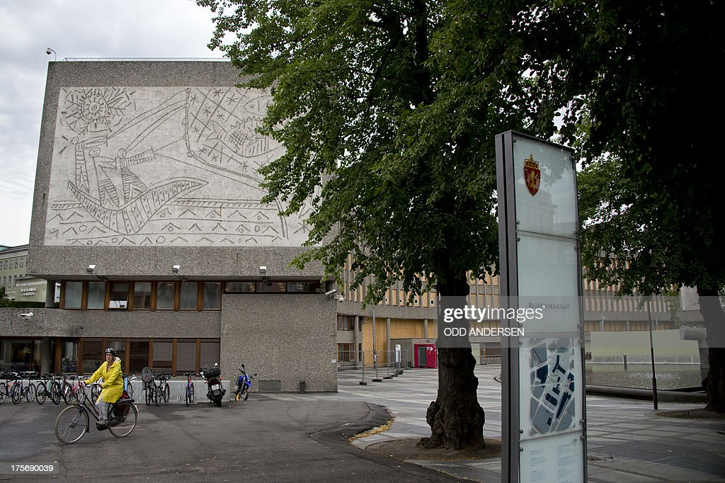 A woman on a bicycle passes Picasso's mural art work 'The Fisherman' on the government quarter's 'Y building' in Oslo, Norway on August 6, 2013. The art work survived the 22nd July 2011 bombing unscathed, but other government buildings bearing the artist's murals were severely damaged. The Norwegian Directorate for Cultural Heritage fears that Picasso's first monumental concrete murals, which were made between the late 1950s and the early 1970s for two government buildings in Oslo, may be destroyed. The buildings were severely damaged during the deadly terrorist attack in the Norwegian capital in July 2011. The government is now considering whether to demolish the Modernist buildings that form the regjeringskvartal or government quarter.