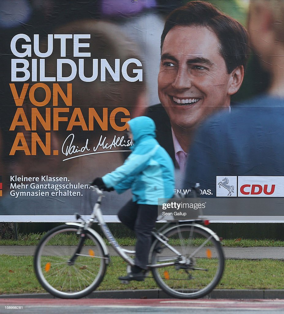 A woman on a bicycle rides past an election campaign billboard featuring Lower Saxony Governor and incumbent candidate of the German Christian Democrats (CDU) David McAllister on January 5, 2013 in Hanover, Germany. Lower Saxony is holding state elections on January 20 and many analysts see the election as a bellwether for national elections scheduled to take place later this year.
