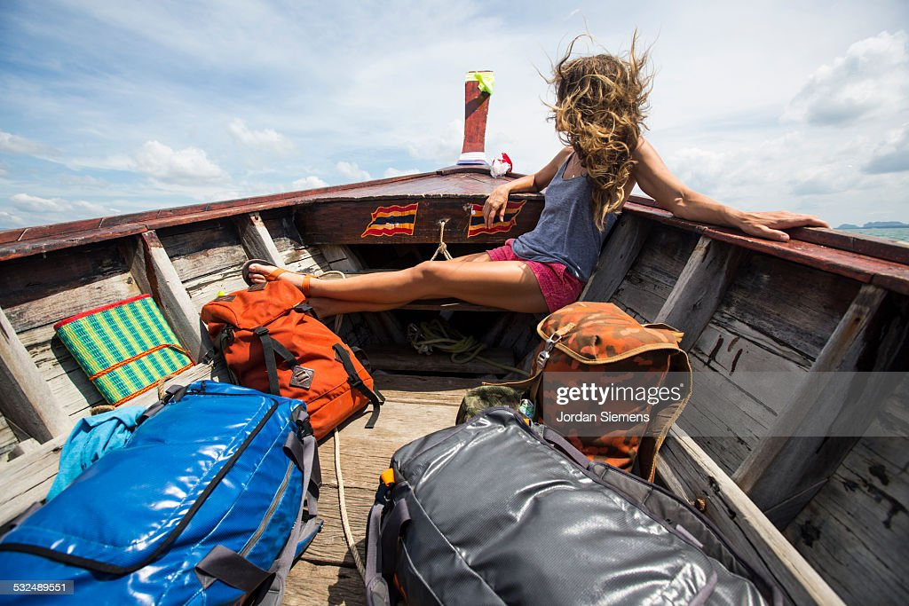 A woman on a boat adventure.