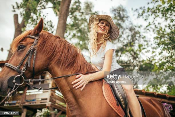 Woman on a brown horse