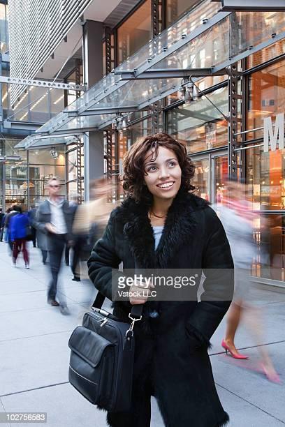 Woman on a busy downtown sidewalk