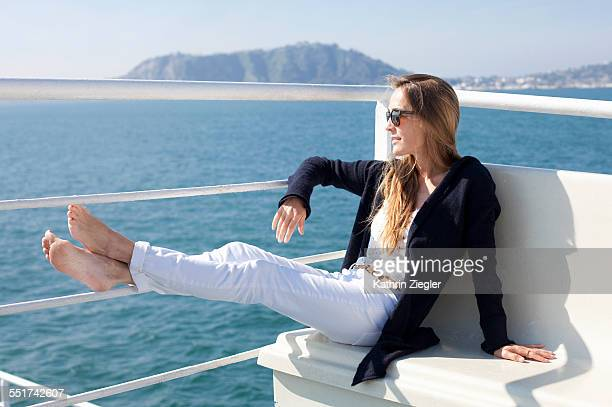 woman on a ferry boat, Gulf of Naples, Italy