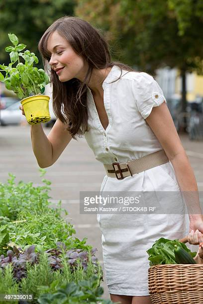 Woman on a market at a herbs stall